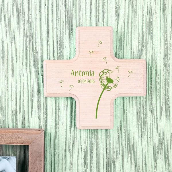 Holzkreuz mit Pusteblume und Fischsymbolen bedruckt
