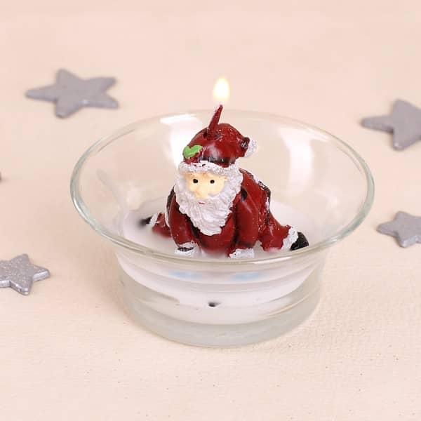 Kerze im Glas mit dem lustigen Weihnachtsmann