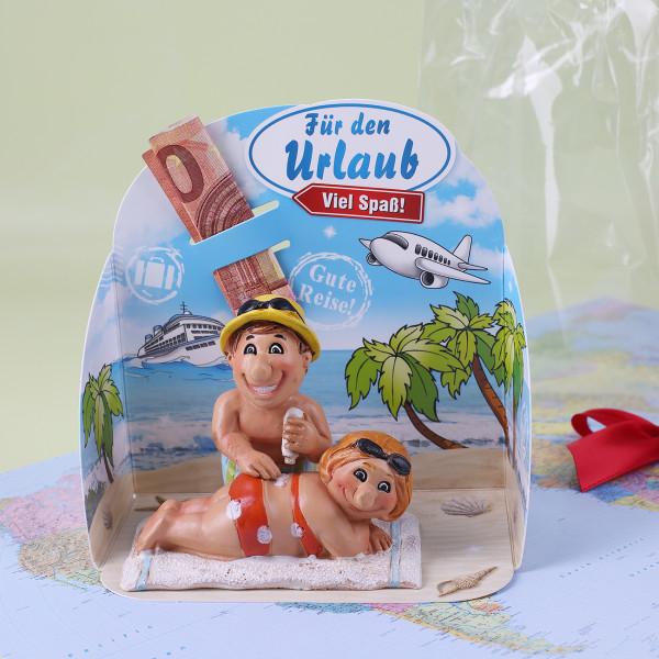 Geldgeschenk für die Reise - Pärchen am Sandstrand
