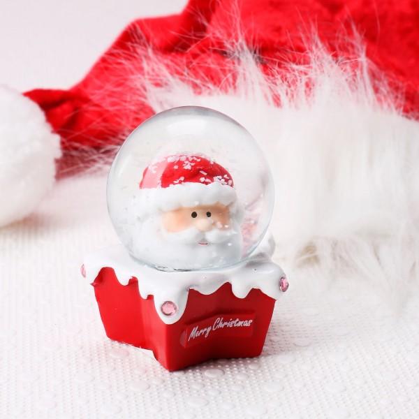 Weihnachtsmann Schneekugel auf rotem Sternen Sockel
