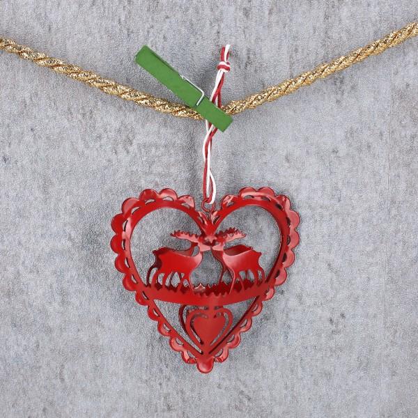 roter Metall-Herzanhänger mit Rentieren