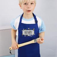 Blaue Werkenschürze für Kinder mit Handwerkermotiv und Namensaufdruck