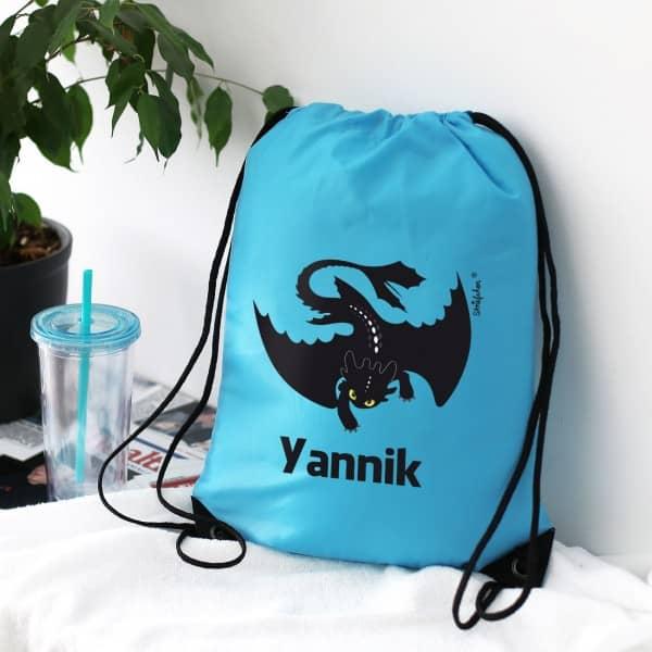 Individuellbabykind - blauer Sportbeutel mit Drache und Namensaufdruck - Onlineshop Geschenke online.de