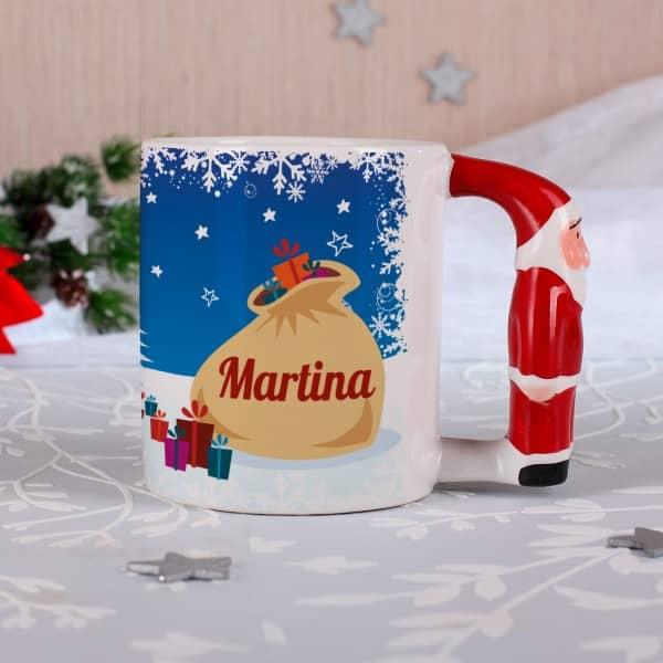 Tasse mit Weihnachtsmanngriff und Geschenkemotiv