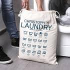 Wäschesack mit lustigen Waschsymbolen und Ihrem Wunschnamen