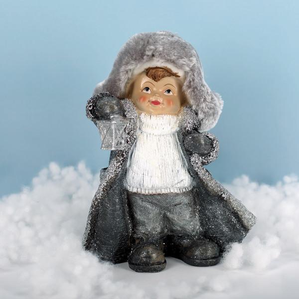 Winterkind mit Latern