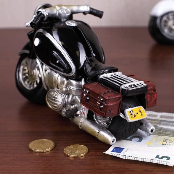 Motorrad als Spardose mit Geldschlitz am Tank