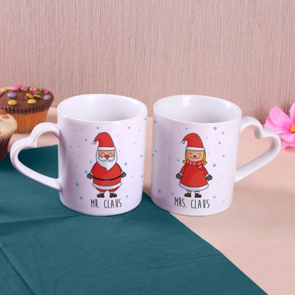 Paartassen mit Herzhenkel und Weihnachtsmotiv