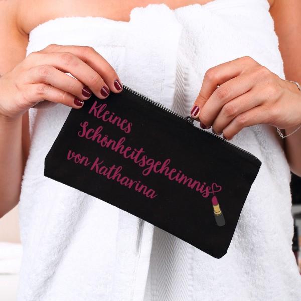 Kleines schwarzes Beautycase mit Schönheitsgeheimnis-Motiv