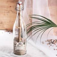 Gefüllte Flaschenpost mit Namensgravur und Steuerrad