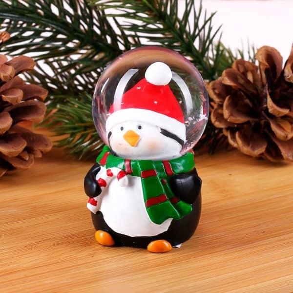 Kleine Schneekugel Pinguin