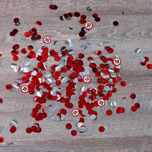 rotes, glänzendes Konfetti und 18er Verkehrsschilder