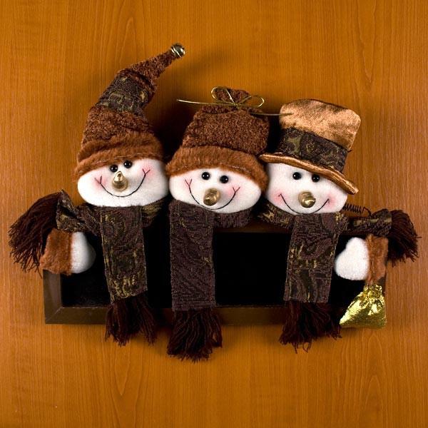 Weihnachtsschild für die Tür mit Schneemännern