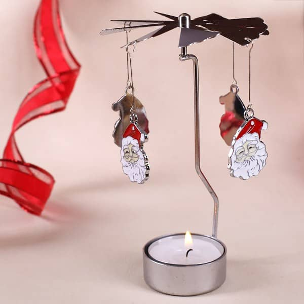 Rotierender Teelichthalter mit Santa Gesicht