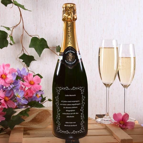 Champagner mit persönlichem Text und verziertem Rahmen