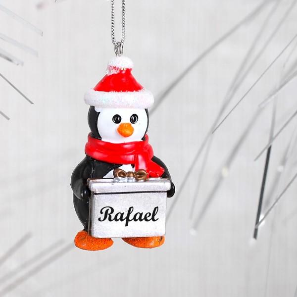 Niedlicher Pinguin mit Geschenk und Wunschnamen