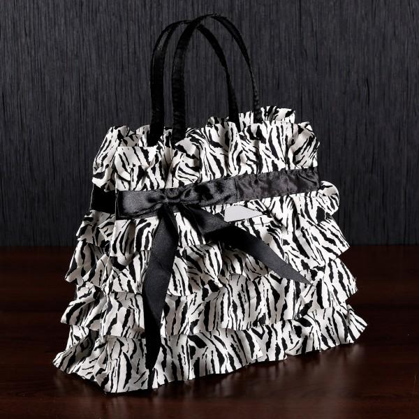 Geschenktüte im Design einer Handtasche mit Zebra-Rüschen