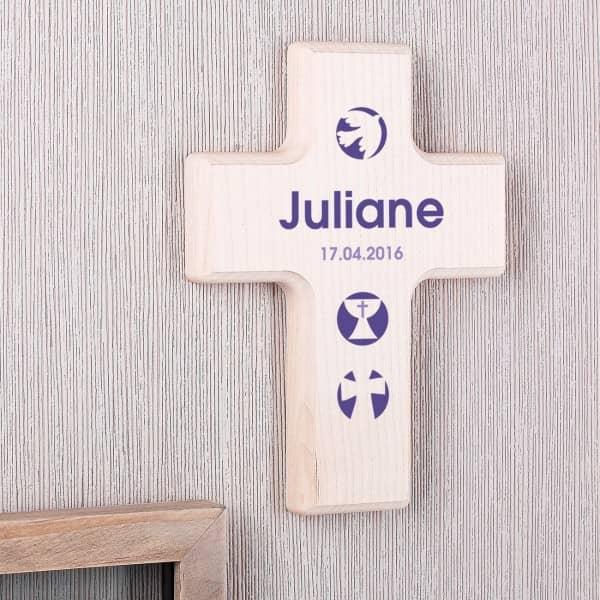 Bedrucktes Holzkreuz mit religiösen Symbolen in Lila
