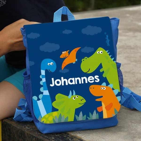 blauer Kinderrucksack mit Dinosauriern und Ihrem Namen
