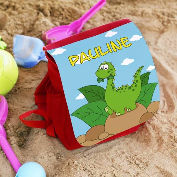Individuellbabykind - Kinderrucksack in blau und rot mit Dino und Wunschname - Onlineshop Geschenke online.de
