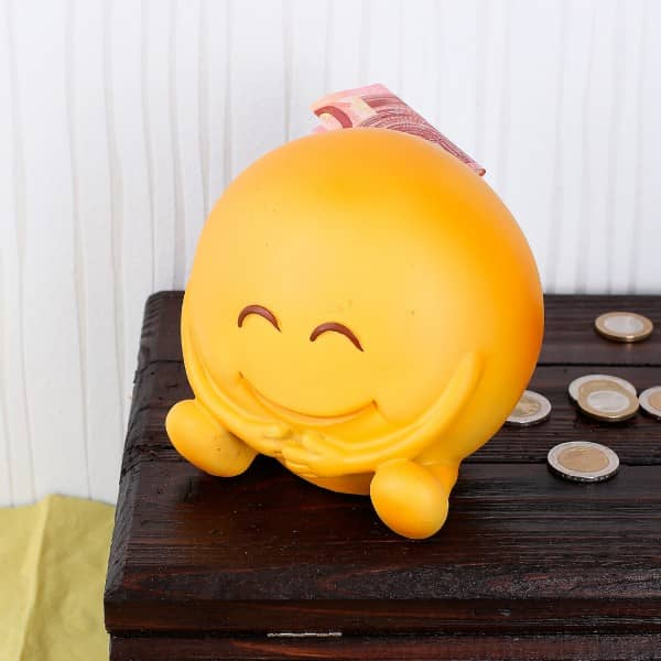 Spardose - glückliches Emoticon