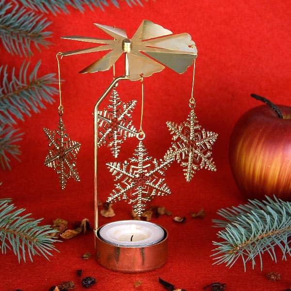 Rotierender Metall-Teelichthalter gold *Schneeflocke*