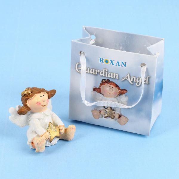 Mini Schutzengel in kleiner Geschenktüte mit Stern in den Händen