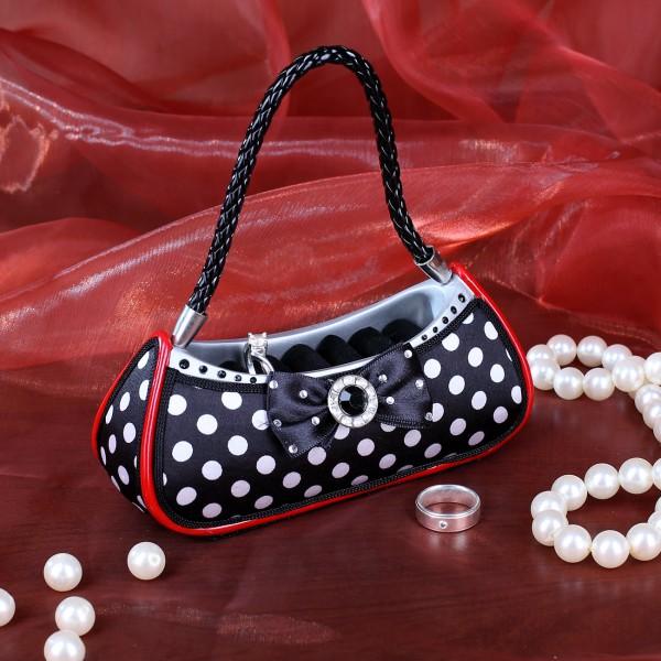 Handtasche als Ringhalter