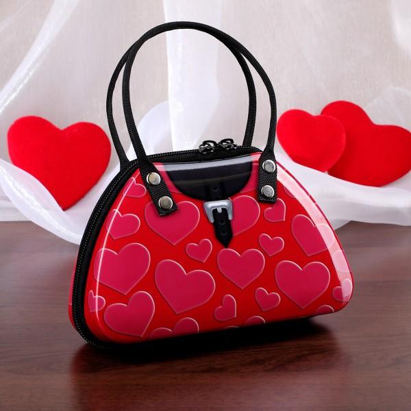 pinke Blechdose in Form einer Handtasche