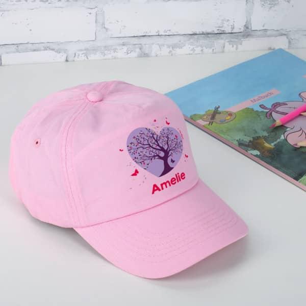 Individuellbekleidung - Basecap in Rosa mit magischem Schmetterlingsmotiv - Onlineshop Geschenke online.de