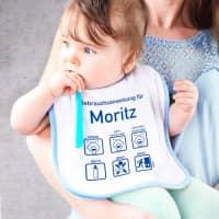Lätzchen mit Gebrauchsanweisung für Baby-Jungen
