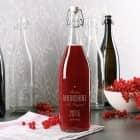 Bügelflasche aus Glas mit 4 Zeilen Wunschtext graviert