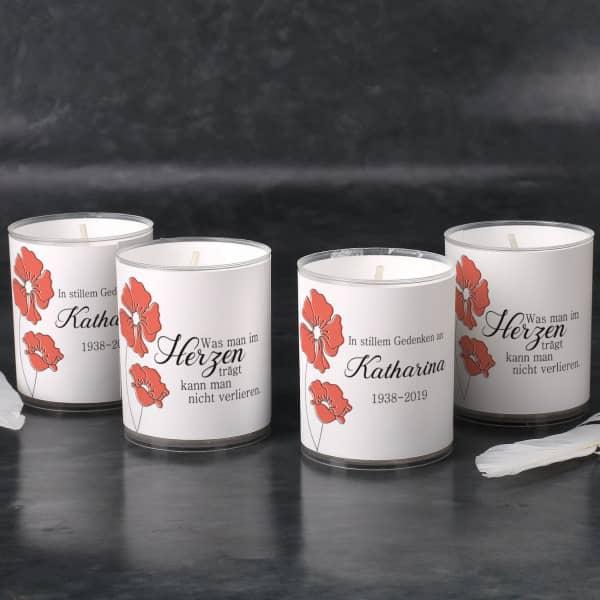 Vier Kerzen mit Trauermotiv Mohnblumen