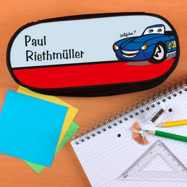 Stiftebox mit lachendem Auto