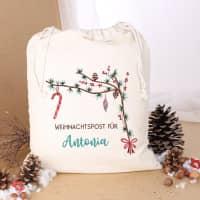 Festlicher Geschenksack mit Zweigen und Wunschtext