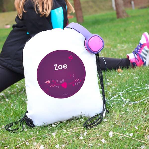 Sportbeutel für Mädchen mit floralem Motiv in violett und Namensaufdruck